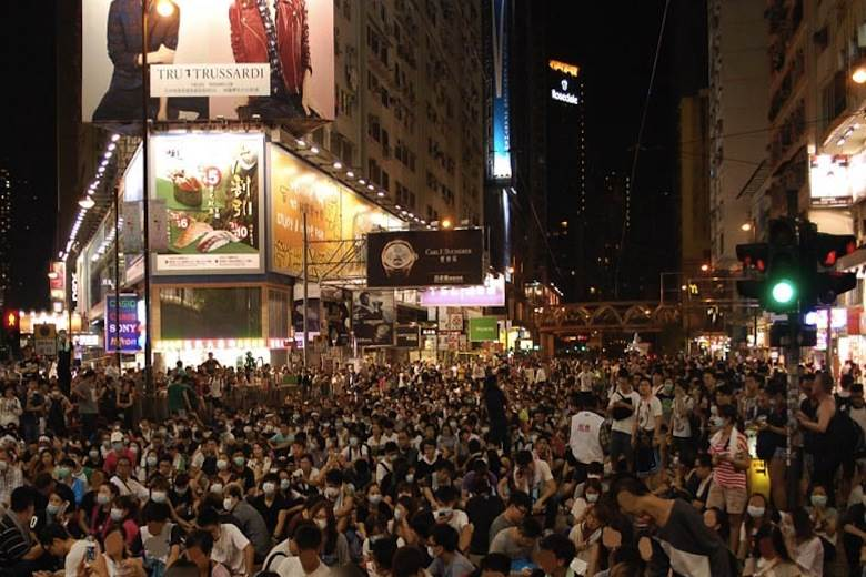 """Hong Kong protests """"not that big a deal, economically"""""""