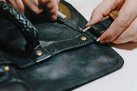 Mulberry wants its customers to think of buying its bags as a way to...